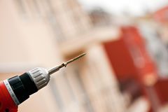 Electric screwdriver with screw. Close up photo of an electric screwdriver with screw Royalty Free Stock Photo