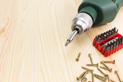 Electric screwdriver and screws Royalty Free Stock Images