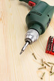Electric screwdriver and screws Stock Photo