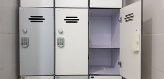 Electric security code locks on three cabinet door stock photo