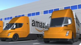 Electric semi-trailer trucks with Amazon logo being loaded or unloaded at warehouse. Logistics related loopable 3D