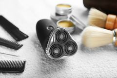 Electric shaver for man. On fabric Stock Photos