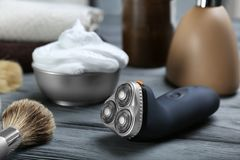 Electric shaver for man. On wooden table Stock Photography
