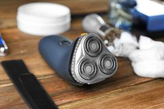 Electric shaver for man. On wooden table Stock Images