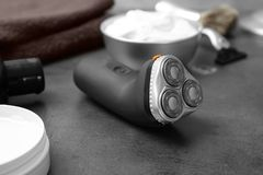 Electric shaver for man. On table Royalty Free Stock Images