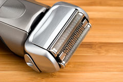 Electric shaver. On a wooden table Stock Photography
