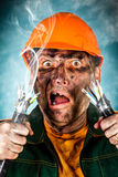 Electric Shock. Sees a shocked electrician man Stock Photo