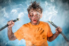 Electric Shock. Boy has a electric shock royalty free stock image