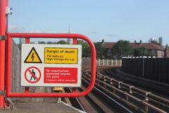 Electric shock hazard no entry or trespassing sign. Near rail or train station Stock Photos