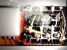 Electric Shock. Overloaded electrical circuit causing electrical short and fire Stock Photos