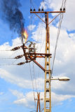 Electric Shock. Power pylon - overloaded electrical circuit causing electrical short Stock Image