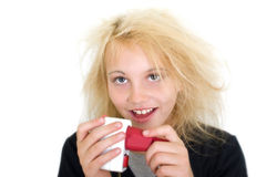 Electric shock. Young girl gets an electric shock stock images