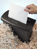 electric shredder surrounded by strips of paper Stock Photos