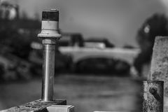 Electric signal lantern on the river water canal, beacon for the boats.  Royalty Free Stock Photo