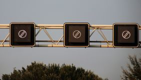 Electric signs above the motorway A20 at Rotterdam to show end of earlier prohibitions in the Netherlands. Electric signs above the motorway A20 at Rotterdam to stock images