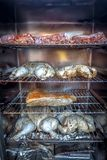 Electric smoker loaded with variety of meat stock photo