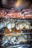 Electric smoker loaded with variety of meat royalty free stock photo