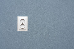 Electric socket. The white electric socket on a blue wall Stock Photos