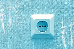 Electric socket, close-up. Electric socket on the wall with blots, close-up royalty free stock photo