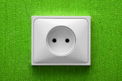 The electric socket in a green wall Royalty Free Stock Image