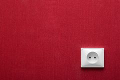 The electric socket in a red wall Royalty Free Stock Photography