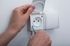 Electric socket repair Stock Image