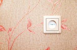 Electric socket at the wall Royalty Free Stock Image
