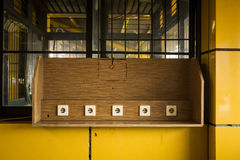 Electric socket on wooden wall at charging facility in train station public area photo taken in Jakarta Indonesia Stock Photo