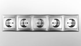 Electric sockets in line Stock Photography
