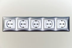 Electric sockets in line Royalty Free Stock Image