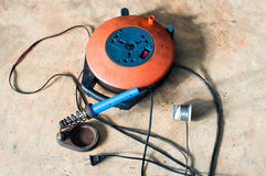 A Electric soldering iron blue handle and Roll of soldering wire w Stock Images
