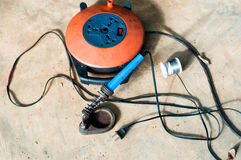 A Electric soldering iron blue handle and Roll of soldering wire w Stock Photo