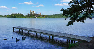 Electric Steam Power Plant on lake. Electric power plant on local lake with ducks and fishing dock Stock Photos