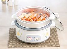 Electric steaming pot. Easy and convenience to cooking food with electric steaming pot such as rice seafood chicken etc stock photos