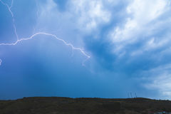 Electric storm. Lightning across the sky in a lightning storm Royalty Free Stock Photo