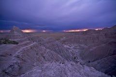 Electric Storm Over Badlands. Lightning Strikes on the Horizon. Badlands National Park, South Dakota, U.S.A. Weather Photography Collection Stock Photos