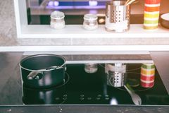 Electric stove. Frying pan is placed on a modern electric stove, black induction stove, cooker stock images