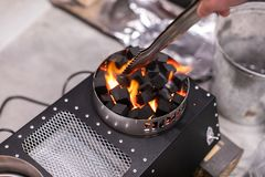 Electric Stove For Ignition Of Coals For Shisha Glowing stock image