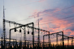 Electric substation. On a background of the coming sun Stock Image