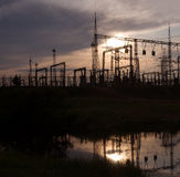 Electric substation. On a background of the coming sun Royalty Free Stock Photos