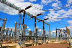 Electric substation in a bright sunny day Royalty Free Stock Images
