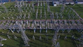 Electric substation, power station, electric tower, power distribution. Early morning spring summer sun shadows. Aerial