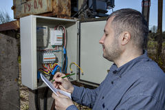 Electric substation, Technician Writing Reading Of electricity M Royalty Free Stock Photos