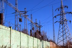 Electric substation and transmission line towers. Royalty Free Stock Photo