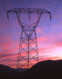 Electric Sunset. High tension tower & wires at sunset stock images