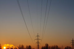 Electric sunset. The photo shows the support power lines Stock Photos