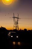 Electric sunset silhouettes Royalty Free Stock Photo