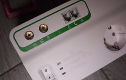 Electric surge protector Close-up and power supply details. Used at home and in the office royalty free stock images