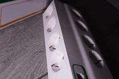 Electric surge protector Close-up and power supply details. Used at home and in the office royalty free stock photo