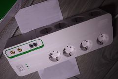 Electric surge protector Close-up and power supply details. Used at home and in the office stock photos